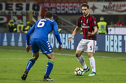 April 8, 2018 - Milan, Milan, Italy - 8th April 2018, San Siro, Milan, Italy; Serie A football, AC Milan versus US Sassuolo; Giacomo Bonaventura of AC Milan ompetes for the ball with Luca Mazzitelli of US Sassuolo (Credit Image: © Gaetano Piazzolla/Pacific Press via ZUMA Wire)