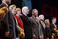 12 JAN 2003, BRAUNSCHWEIG/GERMANY:<br /> Angela Merkel (Mi-L), CDU Bundesvorsitzende, Edmund Stoiber (M), CSU, Ministerpraesident Bayern, und Christian Wulff (Mi-R), CDU Landesvorsitzender Niedersachsen, singen die Nationalhymne, Wahlkampfauftakt der CDU Niedersachsen zur Landtagswahl, Volkswagenhalle<br /> IMAGE: 20030112-01-060<br /> KEYWORDS: Spitzenkandidat, Ministerpräsident,