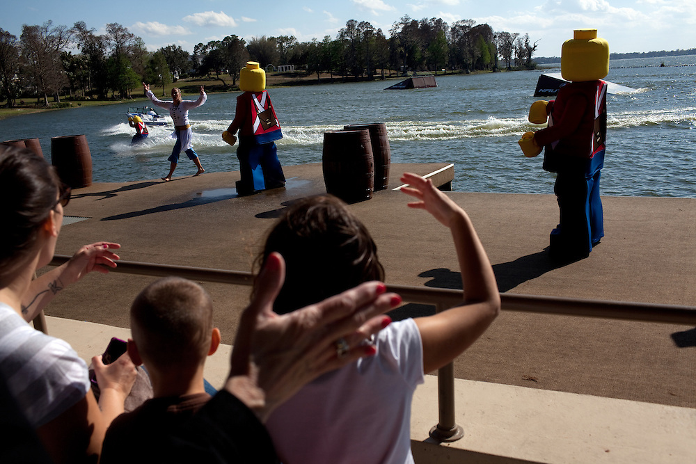 The audience cheer on the lego characters during the Priates' Cove Live Water Ski Show at Legoland in Whitehaven, Florida on February 11, 2012.