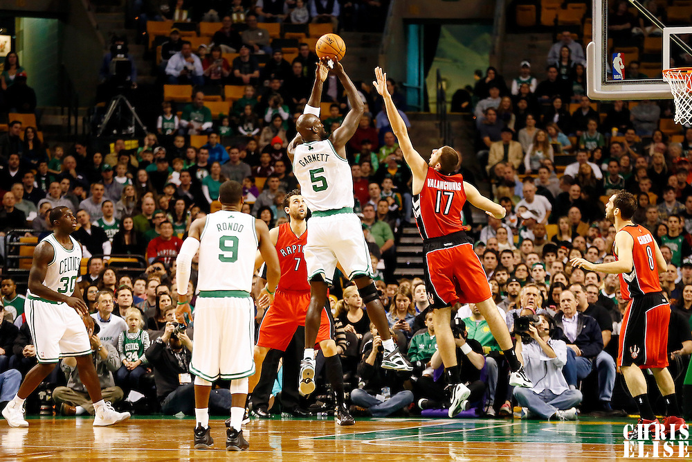 17 November 2012: Boston Celtics power forward Kevin Garnett (5) takes a jumpshot over Toronto Raptors center Jonas Valanciunas (17) during the Boston Celtics 107-89 victory over the Toronto Raptors at the TD Garden, Boston, Massachusetts, USA.