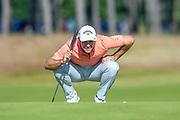 Andrea Pavan (ITA) surveys the line of his putt on the 14th green during the final round of the Aberdeen Standard Investments Scottish Open at The Renaissance Club, North Berwick, Scotland on 14 July 2019.
