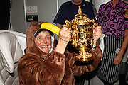 2015 Rugby World Cup Champions, New Zealand All Blacks, and Air NZ Staff take the Webb Ellis Trophy on tour during their Air NZ flight 1, London-LA-Auckland. Monday 2 November 2015. CREDIT: Libby Law COPYRIGHT: LIBBY LAW PHOTOGRAPHY