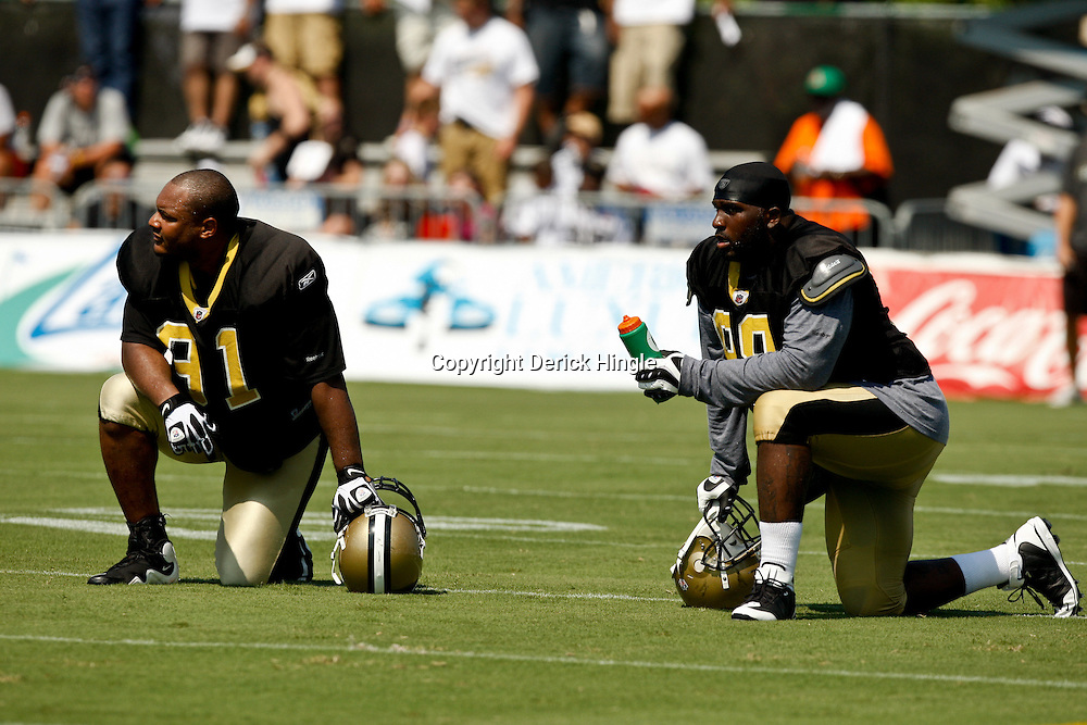 July 31, 2010; Metairie, LA, USA; New Orleans Saints defensive end Will Smith (91) and defensive tackle Sedrick Ellis (98) on the field during a training camp practice at the New Orleans Saints practice facility. Mandatory Credit: Derick E. Hingle