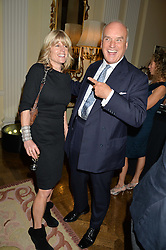 RACHEL JOHNSON and NICHOLAS COLERIDGE at a party to kick off London Fashion Week hosted by US Ambassador Matthew Barzun and Mrs Brooke Brown Barzun with Alexandra Shulman in association with J.Crew hrld at Winfield House, Regent's Park, London on 18th September 2015.