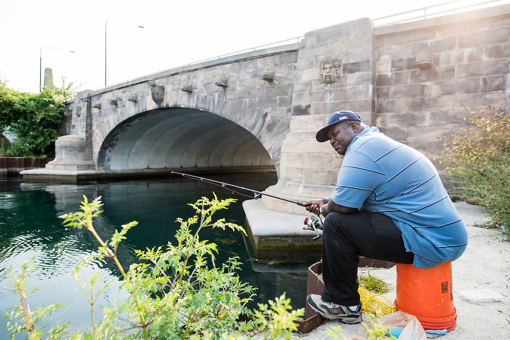 """Danny Howard fishes in the Jackson Park Harbor where he goes to pray and get away. """"You can't beat the serenity being out here, even if you don't catch anything,"""" he says."""