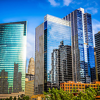 Picture of Chicago Loop downtown city office buildings including the Nuveen curved glass green building. The photo is of the Northwest corner of the Chicago Loop and was taken in 2012.