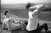 Symond and Gavin sat on a hill, UK, 1980's