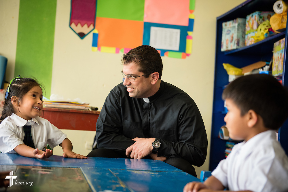 The Rev. Ross Johnson, LCMS director of Disaster Response, visits with children at the Noe school (Spanish for Noah) near Lima, Peru, on Tuesday, April 7, 2015. The school was affected by landslides after heavy rains unleashed avalanches of mud and rocks around the region. LCMS Communications/Erik M. Lunsford