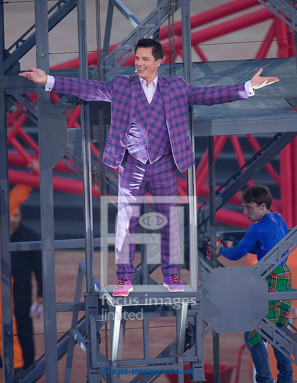 John Barrowman ( L ) performs during the Glasgow 2014 Commonwealth Games Opening Ceremony at Celtic Park, Glasgow<br /> Picture by Paul Terry/Focus Images Ltd +44 7545 642257<br /> 23/07/2014