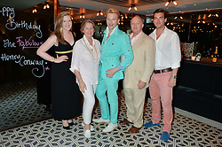 Left to right, CLAUDIA CONWAY, COLLETE CONWAY, HENRY CONWAY, DEREK CONWAY and FREDDIE CONWAY at Henry Conway's 31st birthday party held at the Pont St Restaurant, Belgraves Hotel, London on 12th July 2014.