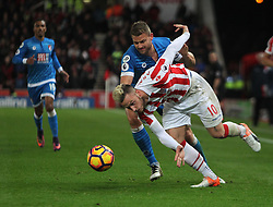 Simon Francis of Bournemouth (L) and Marko Arnautovic of Stoke City in action - Mandatory by-line: Jack Phillips/JMP - 19/11/2016 - FOOTBALL - Bet365 Stadium - Stoke-on-Trent, England - Stoke City v Bournemouth - Premier League