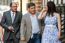 London, UK. 23 July, 2019. Guests including Andrew Bridgen (c), Conservative MP for North West Leicestershire, arrive to attend a celebration in Westminster of Boris Johnson's election as Conservative Party leader and replacement of Theresa May as Prime Minister organised by the pro-Brexit European Research Group (ERG).
