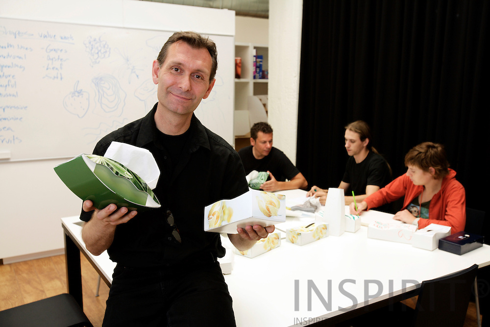 BRUSSELS - BELGIUM - 07 JUNE 2007 -- Swedish Category Designer Fredrik JACOBSSON shows some new tissue-box designs at the SCA (Svenska Cellulosa Aktiebolaget) Packaging Innovation Centre. Sitting at the table from left Wim WOUTERS, Joris SCHEPPERS and Katrien LATHOUWERS. Photo: Erik Luntang