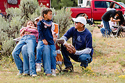 "09 SEPTEMBER 2007 -- ST. MICHAELS, AZ: Spectators at a traditional Navajo Horse Race in the summit area of the Navajo Indian reservation about 10 miles west of St. Michaels, AZ. Traditional horse racing is making a comeback on the Navajo reservation. The races are run on improvised courses that vary depending on the local terrain. Use of saddles is optional (except in the ""Cowhand Race"" which requires a western style saddle) and many jockeys ride bareback. The distances vary from one mile to as long as thirty miles. Traditional horse races were common until the 1950's when they fell out of favor, but there has been a resurgence in traditional racing since the late 1990's and now there is a traditional horse racing circuit on the reservation. The race was organized by the Begay family of Steamboat, AZ and run on private land about three miles from a paved road.  Photo by Jack Kurtz"