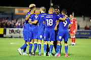 AFC Wimbledon striker Lyle Taylor (33) celebrating after scoring goal to make it 1-0 during the EFL Sky Bet League 1 match between AFC Wimbledon and Gillingham at the Cherry Red Records Stadium, Kingston, England on 12 September 2017. Photo by Matthew Redman.