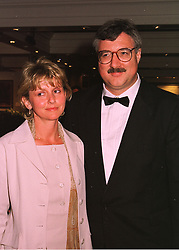 DR & MRS JOHN CROWN he is the leading Irish cancer expert, at a dinner in London on 19th May 1998.MHS 22