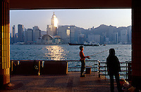 A man fishes in Victoria Harbour off the Promenade in Kowloon, Hong Kong, China.