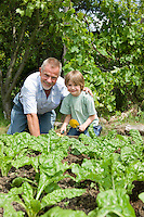Boy gardening with grandfather portrait