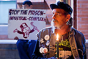 "04 JANUARY 2012 - PHOENIX, AZ:   KEN ALANDT holds a candle during a vigil for Marty Atencio in front of the Maricopa County Jail in Phoenix on January 4. Atencio died in a Phoenix hospital on Dec 20, 2011. He was arrested by Phoenix police a few days earlier after he exhibited ""bizarre"" behavior on the street. He was booked into the Maricopa County Jail. During the booking process he was tackled by Maricopa County Detention Officers and repeatedly hit was a Taser stun gun. He was later found unconscious in a holding cell and transferred to a hospital, where he died four days later. An autopsy showed no signs of illegal drugs or intoxication and a video from the jail showed that Atencio was not violent in the jail. His family has hired a lawyer and may sue the Maricopa County Sheriff's Department, which administers the jail.    PHOTO BY JACK KURTZ"