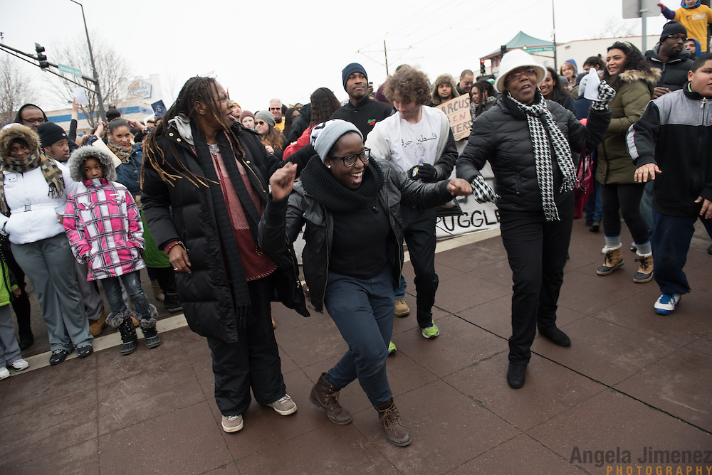 Adja Gildersleve, 26, center, joins in some impromptu dancing with other participants in the #ReclaimMLK march organized by Black Lives Matter Minneapolis in conjunction with Ferguson Action's national day of action on the Rev. Martin Luther King, Jr. national holiday in St. Paul, Minnesota on January 19, 2015 as the march paused at Snelling and University Avenues (the same place where it began).<br />