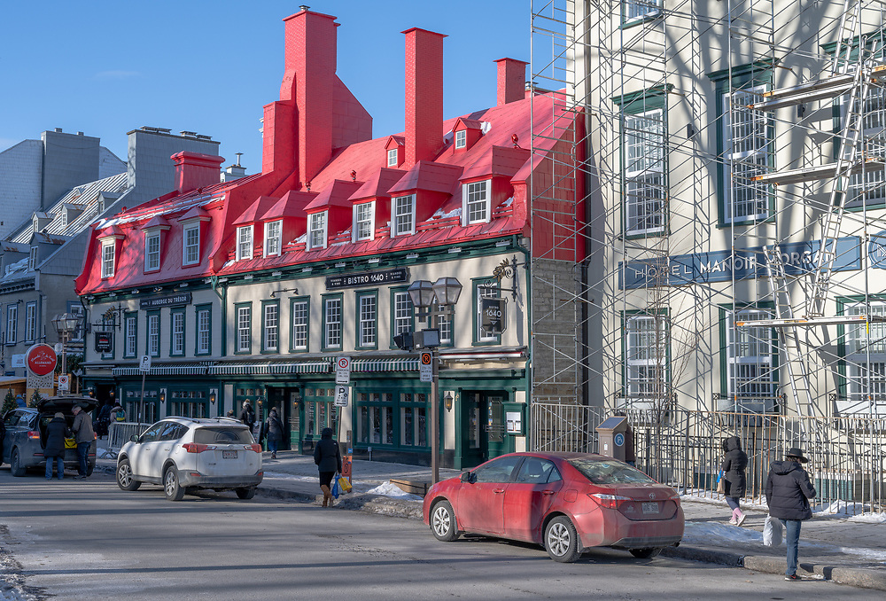 Quebec City, Quebec, Canada -- November 30, 2019. A photo of a side street in Quebec (rue St. Anne) with the popular red roofed Bistro 1640.