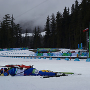 Winter Olympics, Vancouver, 2010. Dana Plotogea, Romania,  collapses at the finish of  the Women's 7.5 KM Sprint Biathlon at The Whistler Olympic Park, Whistler, during the Vancouver  Winter Olympics. 13th February 2010. Photo Tim Clayton