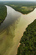 Rewa River (Black Water) flowing into Essequibo River (White Water)<br /> Essequibo River is the longest river in Guyana, and the largest river between the Orinoco and Amazon. Rising in the Acarai Mountains near the Brazil-Guyana border, the Essequibo flows to the north for 1,010 km through forest and savanna into the Atlantic Ocean.<br /> Iwokrama Reserve<br /> GUYANA<br /> South America