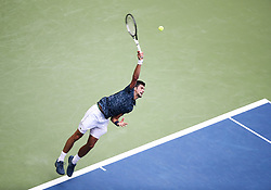NEW YORK, Aug. 29, 2018  Novak Djokovic of Serbia serves during the men's singles first round match against Marton Fucsovics of Hungary at the 2018 US Open tennis championships in New York, the United States, Aug. 28, 2018. Djokovic won 3-1. (Credit Image: © Xinhua via ZUMA Wire)