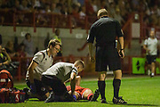 John Busby (Referee) with Ollie Palmer (Crawley Town) while he is assessed during the EFL Cup match between Crawley Town and Norwich City at The People's Pension Stadium, Crawley, England on 27 August 2019.