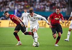 July 31, 2018 - Miami Gardens, Florida, USA - Real Madrid C.F. defender Theo Hernandez (15) wins control of the ball from Manchester United F.C. midfielder Andreas Pereira (15) (left) and defender Matteo Darmian (36) (right) during an International Champions Cup match between Real Madrid C.F. and Manchester United F.C. at the Hard Rock Stadium in Miami Gardens, Florida. Manchester United F.C. won the game 2-1. (Credit Image: © Mario Houben via ZUMA Wire)