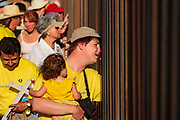 17 APRIL 2005 - NACO, AZ: Progressive Christians on the US side of the US/Mexico border look through the border fence in Naco, AZ. They were looking into Mexico. The Christians had gathered to protest the presence of the  Minuteman Project in Naco. The Minuteman volunteers were hunting migrants who crossed the border outside of Naco.      PHOTO BY JACK KURTZ