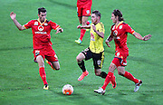 Phoenix' Michael McGlinchey evades two Adelaide defenders during the Round 22 A-League football match - Wellington Phoenix V Adelaide United at Westpac Stadium, Wellington. Saturday 5th March 2016. Copyright Photo.: Grant Down / www.photosport.nz
