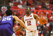 LUBBOCK, TX - MARCH 3: Keenan Evans #12 of the Texas Tech Red Raiders brings the ball up court against Alex Robinson #25 of the TCU Horned Frogs during the game on March 3, 2018 at United Supermarket Arena in Lubbock, Texas. Texas Tech defeated TCU 79-75. Texas Tech defeated TCU 79-75. (Photo by John Weast/Getty Images) *** Local Caption *** Keenan Evans;Alex Robinson