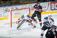 KELOWNA, CANADA - FEBRUARY 9: Jared Bethune #21 of Prince George Cougars jumps in front of the net of Jake Morrissey #31 of Kelowna Rockets on February 9, 2015 at Prospera Place in Kelowna, British Columbia, Canada.  (Photo by Marissa Baecker/Shoot the Breeze)  *** Local Caption *** Jared Bethune; Jake Morrissey;