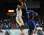 """Ole Miss' Dundrecous Nelson (5) shoots over SMU's Ryan Manuel (1) at the C.M. """"Tad"""" Smith Coliseum in Oxford, Miss. on Tuesday, January 3, 2012. Ole Miss won 50-48."""