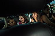 Yuliana Viloria (c) y su prima, Valentina Mussett (d) ríen mientras observan a Miguel Alejandro (i) en el carro de su madre, Marina Mujica. Gracias a FundaHigado, Yuliana recibió un trasplante de higado que le permite disfrutar de la vida. Punto Fijo, Venezuela 26 y 27 Oct. 2012. (Foto/ivan gonzalez)