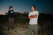 Mark Dodd, State Sea Turtle Program Coordinator of the Georgia Department of Natural Resources, waits with Sarah Rose, a sea turtle technician, for the tide to recede before the start of a night of searching, tagging, and gathering data from nesting sea turtles on Ossabaw Island, Georgia, June 17 and 18, 2012.
