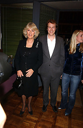 Left to right, CAMILLA PARKER BOWLES and her children TOM PARKER BOWLES and LAURA PARKER BOWLES at a party to celebrate the publication of 'E is for Eating' by Tom Parker Bowles held at Kensington Place, 201 Kensington Church Street, London W8 on 3rd November 2004.<br />