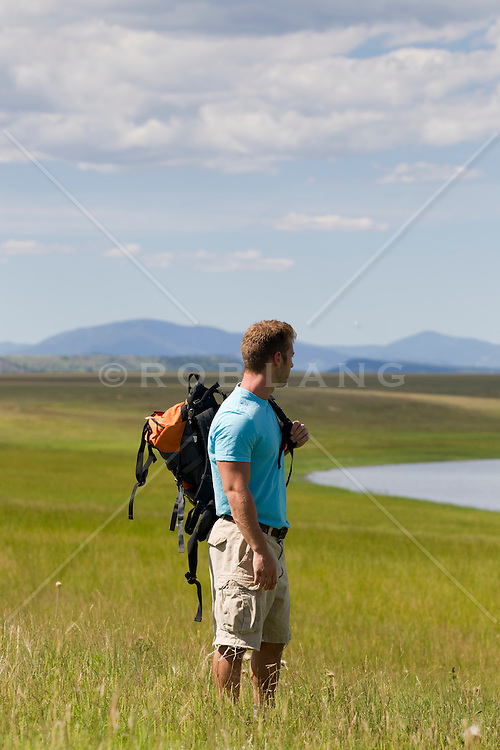 man with a backpack looking at am amazing landscape in New Mexico