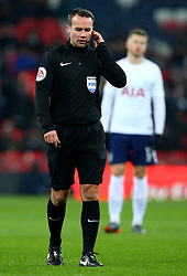 Referee Paul Tierney speaks to VAR before disallowing an Erik Lamela of Tottenham Hotspur goal - Mandatory by-line: Robbie Stephenson/JMP - 28/02/2018 - FOOTBALL - Wembley Stadium - London, England - Tottenham Hotspur v Rochdale - Emirates FA Cup fifth round proper