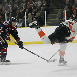 COCHRANE, ON - MAY 3: Eli Hernandez #5 of the Cochrane Crunch tries to keep the puck from George Young #21 of the Hearst Lumberjacks during the first period on May 3, 2019 at Tim Horton Events Centre in Cochrane, Ontario, Canada.<br /> (Photo by Tim Bates / OJHL Images)