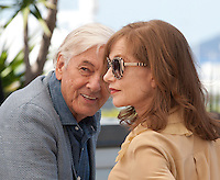 Director Paul Verhoeven and actress Isabelle Huppert at the Elle film photo call at the 69th Cannes Film Festival Saturday 21st May 2016, Cannes, France. Photography: Doreen Kennedy