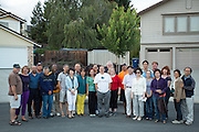Friends and neighbors pose for a portrait during the Princess Place National Night Out party in Milpitas, California, on August 8, 2013. (Stan Olszewski/SOSKIphoto)