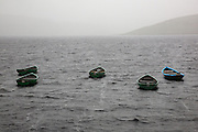 Pleasure boats at Daer Reservoir in the rain, Southern Uplands, Scotland