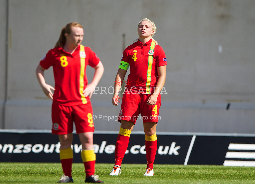 LLANELLI, WALES - Thursday, August 22, 2013: Wales' captain Lauren Price looks dejected as England score the opening goal during the Group A match of the UEFA Women's Under-19 Championship Wales 2013 tournament at Parc y Scarlets. (Pic by David Rawcliffe/Propaganda)