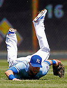 Kansas City Royals left fielder Alex Gordon hits the turf after catching a fly ball by Cleveland Indians' Michael Bourn in the second inning of a baseball game at Kauffman Stadium in Kansas City, Mo., Wednesday, June 11, 2014.  (AP Photo/Colin E. Braley)
