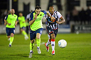Havant & Waterlooville defender Edward Harris holds off Maidenhead United midfielder Adrian Clifton during the Vanarama National League match between Maidenhead United and Havant & Waterlooville FC at York Road, Maidenhead, United Kingdom on 26 March 2019.