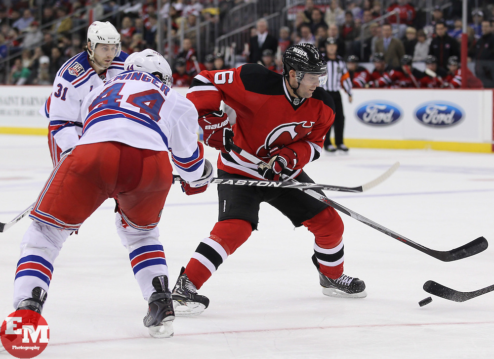 Nov 5, 2010; Newark, NJ, USA;  New York Rangers defenseman Steve Eminger (44) defends against New Jersey Devils defenseman Andy Greene (6) during the third period at the Prudential Center. The Rangers defeated the Devils 3-0.