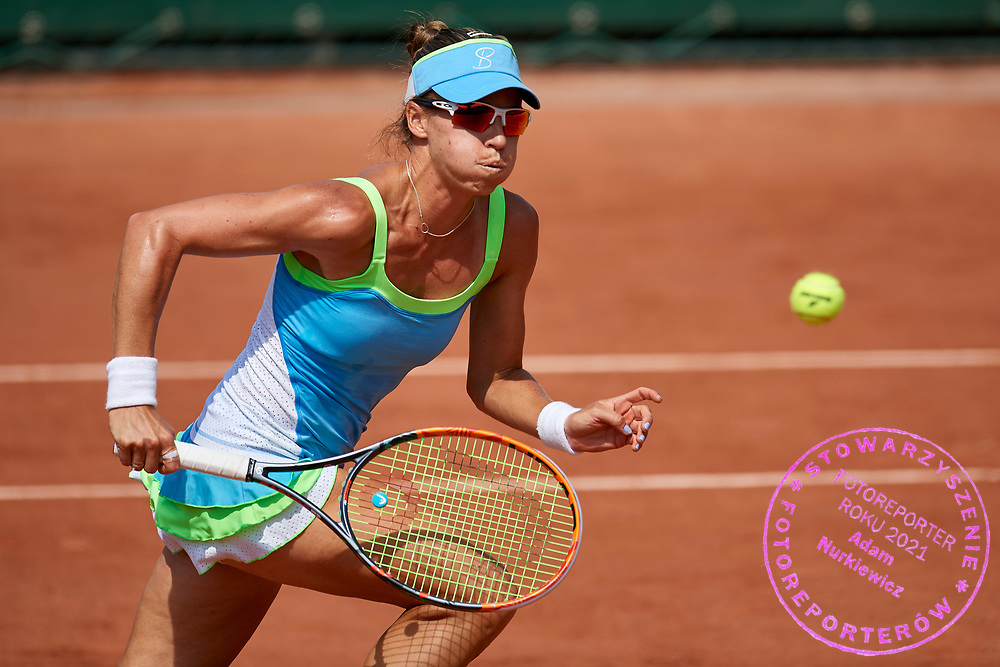 Paris, France - 2017 June 02: Alicja Rosolska from Poland runs and looks at the ball while her women's double match second round during tennis Grand Slam tournament The French Open 2017 (also called Roland Garros) at Stade Roland Garros on June 02, 2017 in Paris, France.<br /> <br /> Mandatory credit:<br /> Photo by &copy; Adam Nurkiewicz<br /> <br /> Adam Nurkiewicz declares that he has no rights to the image of people at the photographs of his authorship.<br /> <br /> Picture also available in RAW (NEF) or TIFF format on special request.<br /> <br /> Any editorial, commercial or promotional use requires written permission from the author of image.