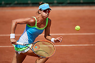 Paris, France - 2017 June 02: Alicja Rosolska from Poland runs and looks at the ball while her women's double match second round during tennis Grand Slam tournament The French Open 2017 (also called Roland Garros) at Stade Roland Garros on June 02, 2017 in Paris, France.<br /> <br /> Mandatory credit:<br /> Photo by © Adam Nurkiewicz<br /> <br /> Adam Nurkiewicz declares that he has no rights to the image of people at the photographs of his authorship.<br /> <br /> Picture also available in RAW (NEF) or TIFF format on special request.<br /> <br /> Any editorial, commercial or promotional use requires written permission from the author of image.